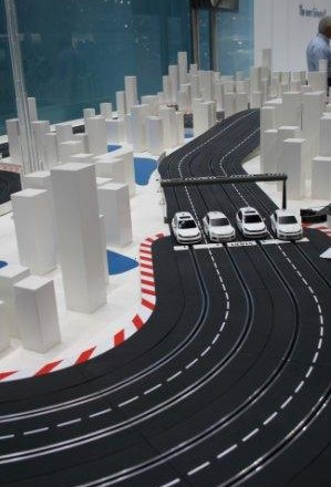 The miniature Carrera Race track at VW, built around a complicated city landscape.