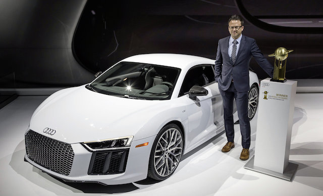 """Roland Schala, Audi R8 Project Manager, with the R8 Coupé and the """"2016 World Performance Car"""" award."""