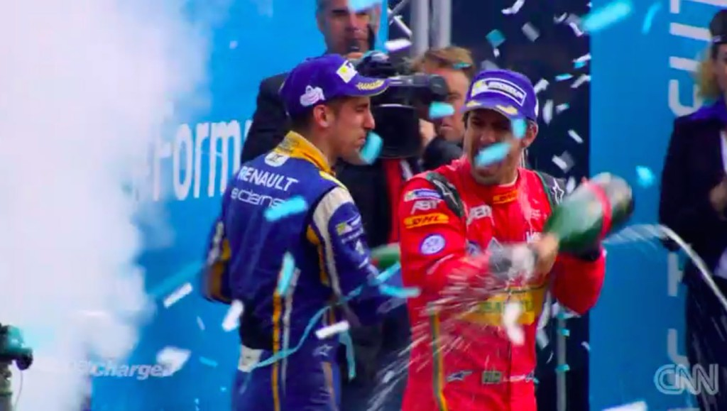 The top two racers celebrating with champagne